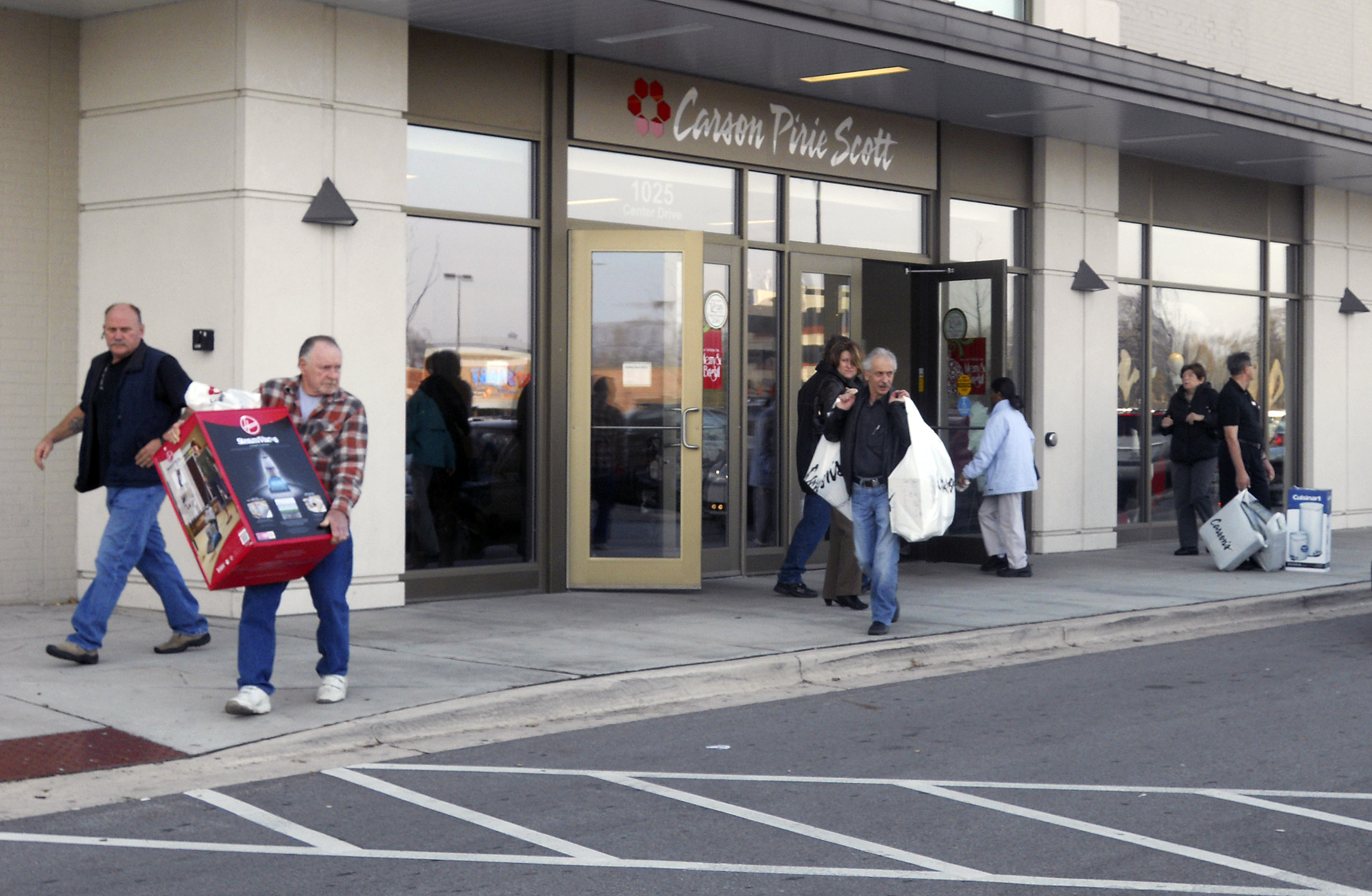 shoppers exit carson pirie scott in mount prospect on black friday the day after thanksgiving 2011 journal file photo