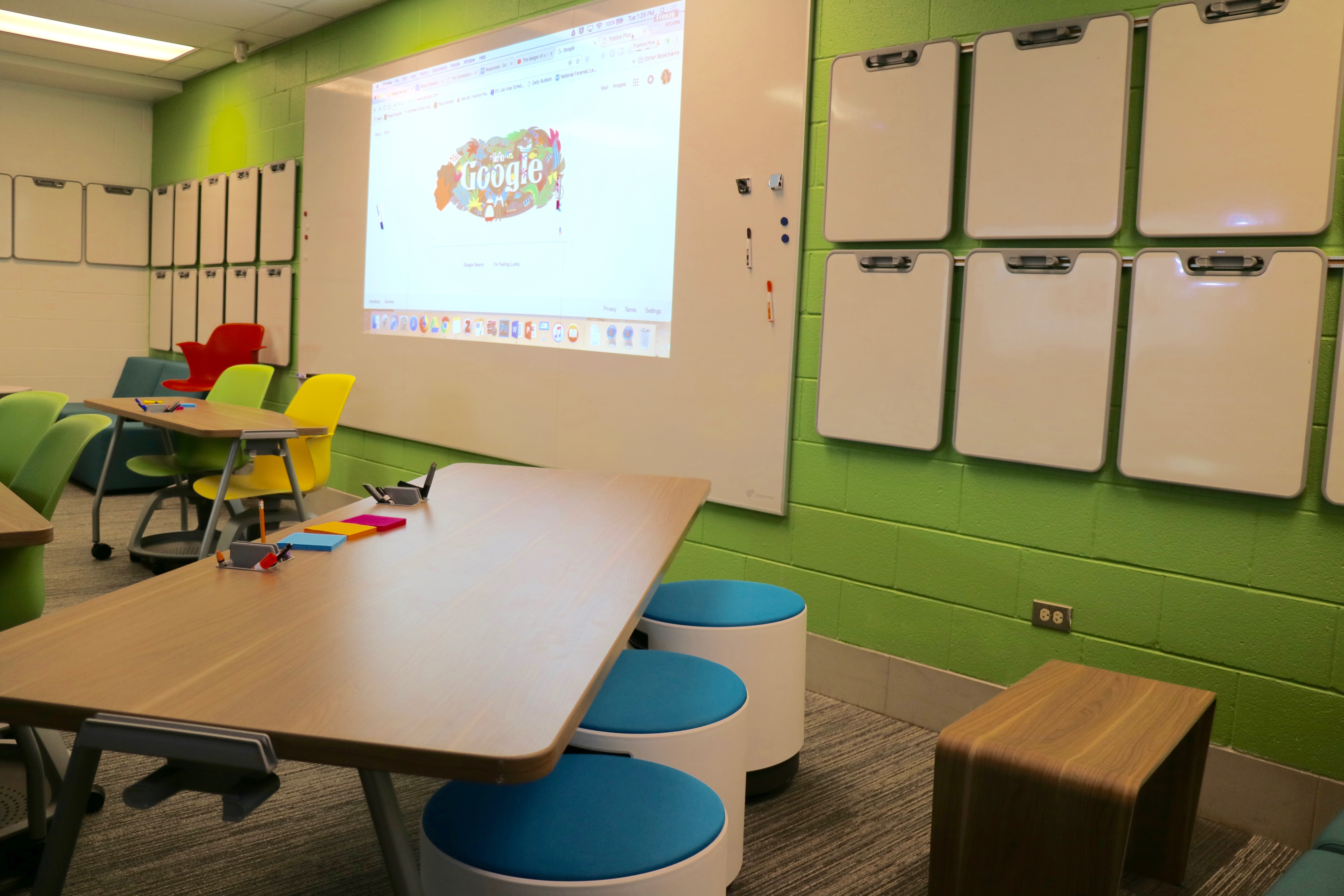 Classrooms Have Chairs And Short Stools, Tables For Group Work And  Individual Desks.